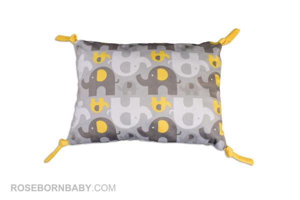 Picture of knot shape pillow yellow elephant